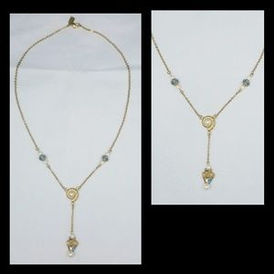 Vintage 1928 Signed Gold Tone Dangling Faux Pearl,